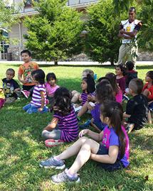 Story time outside with Gadugi scholars and kindergarteners