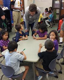Gadugi scholar talking to a table of kindergarteners