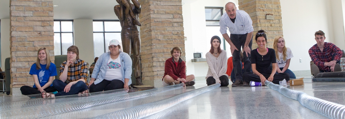 Instructor Jeff Goodman with students doing an interactive lesson with springs