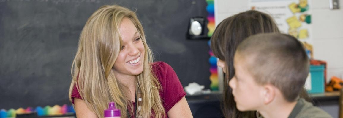 Student teacher with children