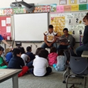 Kindergarten class listening to Gadugi scholars reading Cherokee stories