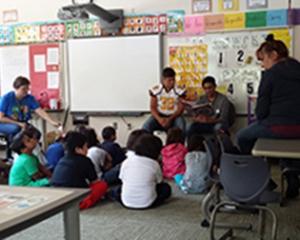 Kindergarten class listening to Gadugi scholars reading Cherokee stories